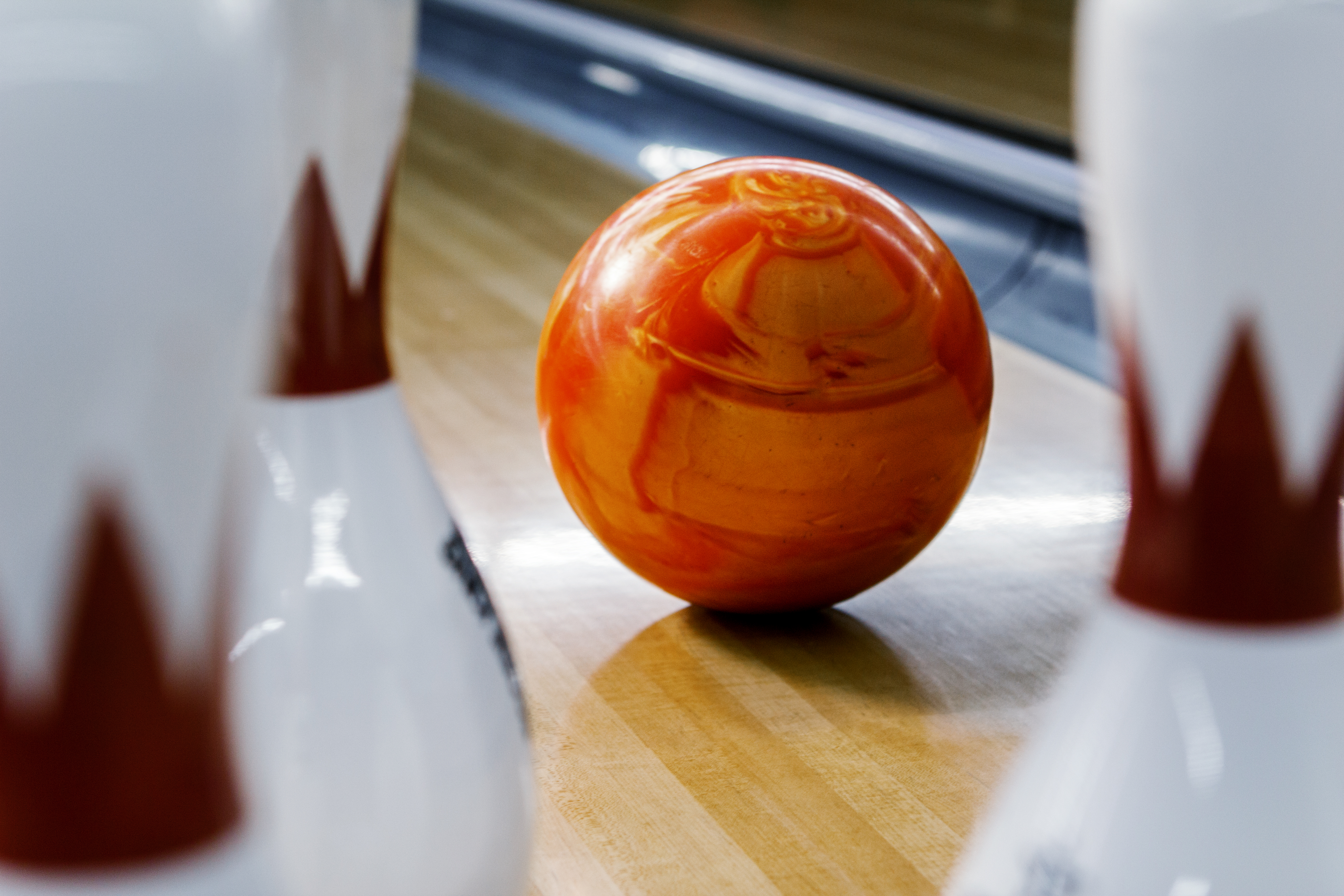 Bowling ball heading towards pins